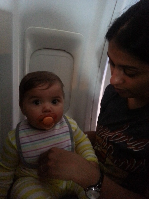 Taking it all in on her first plane ride