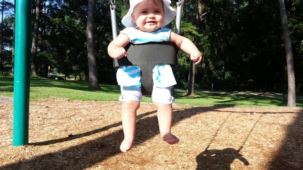 Enjoying her first swing ride