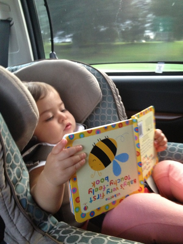 Nothing helps time pass on a road trip like a good book (even if it's upside down)